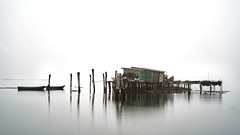 venice (Roberto.Trombetta) Tags: italy venice fog casoni winter boat fishing house long exposure pellestrina island home still venezia veneto lagoon laguna acqua reflection sony 7rii alpha batis zeiss carlzeiss art fineart amazing stunning beautiful landscape paesaggio 7rm2 peaceful calma quiet calm wood wooden mist haziness misty foschia italia legno surreal batis1885 85