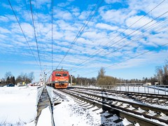One-point perspective colorful Train (St Basoff) Tags: train electric wires perspective em12 olympus mft 1122mm winter snow sunny sky beautiful directpositive wide railway