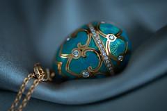 Sleepy faberge egg (annacajem) Tags: blue enamel jewelry macromondays diamonds necklace gold silk egg faberge