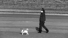 Seaside Strolling 06 (byronv2) Tags: edinburgh edimbourg scotland sea seaside coast coastal peoplewatching candid street walking water river rnbforth firthofforth riverforth forth portobello blackandwhite blackwhite bw monochrome dog
