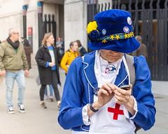 The NHS & EU - Explored (DobingDesign) Tags: streetphotography putittothepeoplemarch london candid onthephone blue hat costume redcross nursesuniformcostume velvet thebestdealiswitheu florencenightingale nurse apron streetcandid protestors marcher londonmarch