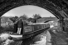 Narrow boat (deltic17) Tags: boat narrow narrowboat canal waterway water bridge waving canon photograph photography blackwhite monochrome