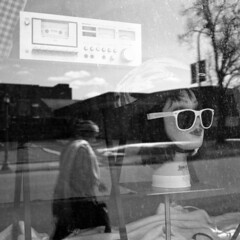 untitled (kaumpphoto) Tags: rolleiflex 120 tlr ilford bw black white street urban city window display glasses reflection cassette stereo head lips dial knob minneapolis oldschool