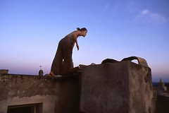 girl on rooftop (playapic) Tags: girl rooftop sunrise bluesky earlymorning venasque provence france outdoors
