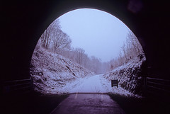 tunnel vision (Ron Layters) Tags: monsaltrail snow winter badweather millersdale oldrailway signpost wyevalley tunnel negativespace cheetornumber1tunnel trees cutting white peakdistrict england wormhill derbyshire unitedkingdom slidefilmthenscanned slide transparency fujichrome velvia canoneos300v canon eos300v rebelti ronlayters