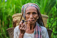 The Tribal Women (Galib Emon) Tags: thetribalwomen portrait marmatribe chittagonghilltracks energetic face smoking traditionalpipe morning strong hardworkinglady bandarban chittagong bangladesh hilltrack canon explore travel colors beautiful women tribe