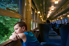 First Class (Chancy Rendezvous) Tags: chancyrendezvous davelawler blurgasm essex railroad connecticut steam train coach car rail travel tour vacation pensive child charlie kid window light seats lawler