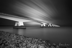 Zeeland Bridge in BW II (Alec Lux) Tags: bw bnw architecture art black blackandwhite bridge clouds exterior fine fineart haida haidafilters longexposure minimal minimalism netherlands outdoor outside sky stairs sun sunset water white zeeland nl