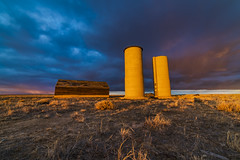 Sister Silos Revisited (Tom Herlyck) Tags: america bigsky colorado digital easterncolorado flickr goldenlight highplains jazzed light national outside ranch sunset tall usa view weather art beautiful clouds silo barn