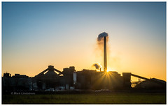 Cement Sunrise (Mark Lindstrom) Tags: microfourthirds photography landscape environment environmental smoke chimneystack bracketed olympus1240pro olympusem1mk2 cemex southferriby clearsky sunburst industrial cementworks sunrise
