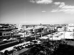 Panning Through a Panoramic View, Grayscale Video (sjrankin) Tags: 18february2019 edited kitahiroshima hokkaido japan snow ice weather sky cityhall clouds buildings parkinglot cars roads stores grayscale video