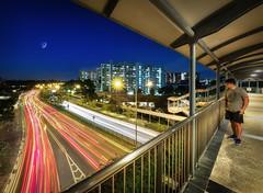 On the quiet bridge (Rexer Ong) Tags: bridge building lights city uurban man tree lamp moon crescent
