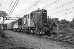 New Haven Railroad GP-9 DERS-4 class diesel electric locomotive # 1207 & FA-1 DER-2a class locomotive # 0401 is seen while leading an eastbound manifest freight train HN-2 at Stamford, Connecticut, 8-30-1968 (alcomike43) Tags: newhavenrailroad nynhh railroads trains freighttrains manifestfreighttrains tracks rails electrifiedmainline mainline ties roadbed ballast rightofway jointedsectionrail catenary catenarysupportstructure electrification gp9 1207 fa1 0401 engines diesels dieselengine diesellocomotive dieselelectriclocomotive emd alco photo photograph negative bw blackandwhite old historic vintage classic engineer employee crewman cabcrew brakeman ders4 der2a