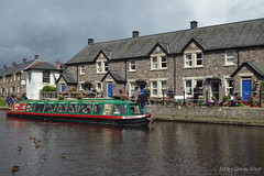 Monmouthshire and Brecon Canal (ExeDave) Tags: p1080376 brecon monmouthshire canal mid wales august 2017 waterway watercourse landscape townscape town cottages buildings architecture stone barge boat dragonfly cruises houses ducks mallard aberhonddu powys