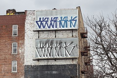 Billboards stripped and graffiti-tagged, possibly in Bengali, Parkchester, Bronx (Eating In Translation) Tags: bronx parkchester translation
