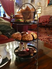 A tea that you need an afternoon for (gowersaint) Tags: plates hotel historic furniture carpet northumbria langleycastle atmosphere chairs table eclairs scones chips meat sweet savory cakes plate afternoontea castle tea burger food