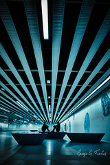 Next station (Sergio G. Fuertes) Tags: symmetry barcelona low angle vanishing point architectural architecture people mirror building diagonal full length vertical metro subway suburban day dark interaction dialogue