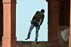 Lean Out (Pedestrian Photographer) Tags: boy teen male lean leaning out window architecture fahtepur sikri india indian site fort ancient bare foot feet fatehpur