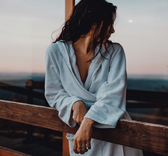 Woman In Bathrobe (SplitShire) Tags: fashion girl people portrait bench photography woman adult sitting table outdoor looking jacket furniture person one clothing wooden wear leg outerwear gown facialexpression robe sleeve neck arm blazer longsleeve