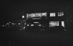 Oakville - After Dark (Alex Luyckx) Tags: oakville ontario canada downtown historic historicdowntown urban town night nightlife afterdark dark highway2 thekingshighway lakeshoreroad nikon nikonf5 slr 135 35mm afsnikkor1424mm128g kodak kodaktmaxp3200 tmz p3200 asa6400 tmax kodaktmaxdeveloper tmaxdeveloper 14 bw blackwhite nikoncoolscanved adobephotoshopcc film filmphotography believeinfilm filmisalive filmisnotdead