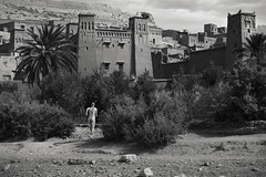The man in the wild (felixoechsli) Tags: marocco aitbenhaddou running akt naked blackwhite bw nature culture art palm travel clouds village movement motion sand shadows