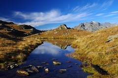 San Gottardo (Tjaldur66) Tags: mountains swissmountains swissalps sangottardo centralswitzerland landscape scenery outdoor hiking fall autumn autumncolours lake mountainlake clouds rocks peaks