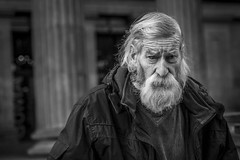 Bloodshot (Leanne Boulton (Catching Up)) Tags: urban street candid portrait portraiture closeup streetphotography candidstreetphotography candidportrait streetportrait eyecontact candideyecontact streetlife old elderly man male face eyes expression mood feeling emotion bloodshot beard hair stories character powerful tone texture detail depthoffield bokeh naturallight outdoor light shade city scene human life living humanity society culture lifestyle people canon canon5dmkiii 70mm ef2470mmf28liiusm black white blackwhite bw mono blackandwhite monochrome glasgow scotland uk