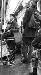 Your Not Having My Seat (tcees) Tags: parismétroline2 paris france x100 fujifilm finepix urban streetphotography street bw mono monochrome blackandwhite man woman people train underground metro seat stool bag scarf pole rucksack handle