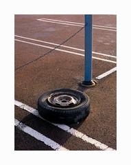 Wheel (ulf_finndahl) Tags: urbancomposition urbanlandscape mundane composition minimalism minimal wheel tyre ulffinndahl asphalt parking