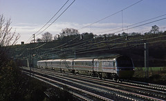This Cross Country Trains HST set on an early morning Bournemouth-Manchester train has been diverted at  Reading to run via London and the WCML during October 1996. Seen north of Linslade Tunnel.           . (mikul44171) Tags: crosscountry ic125 hst diverted rerouted wcml october1996 linslade linsladetunnel contrejour backlighting backlit glint