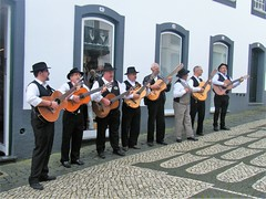 Praia Da Vitoria, the Azores = Street singers (rossendale2016) Tags: portugal azores nearby airport air terminal ship cruise restaurants cafes bars shops sandclean marina harbour ships photographic photograph photogenic icon shirts buckles shoes white black costume national iconic tourism accordian piano guitar tourist seaside sea roads streets destination resort holiday musicians music street accomplished