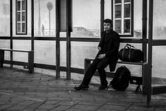 The Shelter (Leanne Boulton) Tags: monochrome urban street candid portrait streetphotography candidstreetphotography candidportrait eyecontact candideyecontact streetlife man male face eyes expression mood feeling posture sitting bus shelter public transport seaside juxtaposition window frames one texture detail depthoffield bokeh naturallight outdoor light shade city scene human life living humanity society culture lifestyle people canon canon5dmkiii 70mm ef2470mmf28liiusm black white blackwhite bw mono blackandwhite brighton england uk