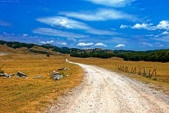Wild Wild West (In Italy) (Claudio_R_1973) Tags: mountain trail road landscape countryside dry drought summer sunny outdoor clouds sky vivid filmlike westernlike d70s