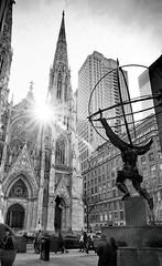 On 5th (Dan Haug) Tags: 5thavenue atlas rockefellerplaza streetphotography stpatrickscathedral newyorkcity nyc manhattan midtown sunstar flare statue bronze fujifilm fujixseries xt3 xf1655mmf28rlmwr xf1655 mirrorless monochrome blackandwhite acros