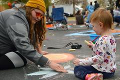 A little guidance (radargeek) Tags: chickasha oklahoma 2018 april montmartrechalkartfestival chalk usao universityofscienceandartsofoklahoma kid child children kids sunglasses ok
