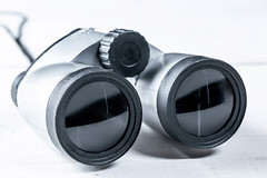 Gray binoculars close-up on white background (wuestenigel) Tags: view instrument color lens nobody concept magnifying lugares glass binoculars background optical black watching looking discovery adventure strategy searching object pair equipment telescope search vision toy surveillance spy white linse ausrüstung zoom zoomen technology technologie noperson keineperson isolated isoliert fernglas electronics elektronik plastic kunststoff aperture öffnung glas optics optik focus fokus desktop power leistung