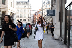 20180716-IMG_4690 (roger_thelwell) Tags: mayfair oxford circus uk london beautiful street photography bw black white portrait people urban city commuters winter cold hat hats mobile phone cell england hair fleet strand life natural walking talking conversation chat speak speaking beauty handbag stud studs lamppost lamp post shiny shiney leather smoking cigarette westminster traffic cab taxi bag sac shoulder mono monochrome great britain streets photographs real photographic photos candid rain umbrella group