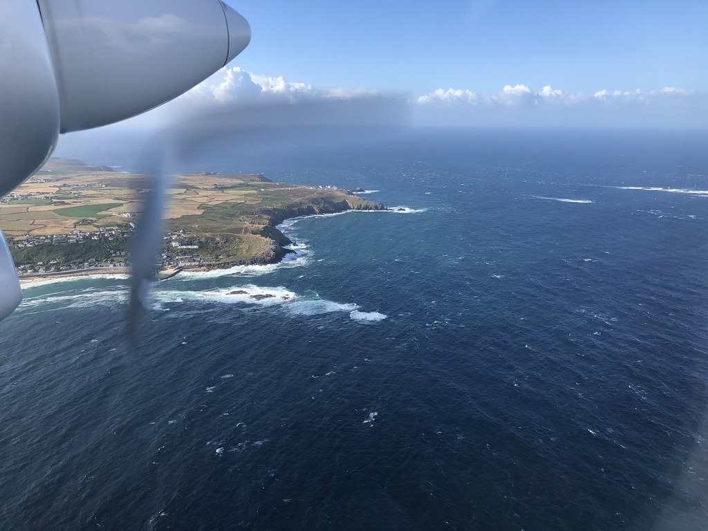 Flying to the Isles of Scilly over Sennen Cove