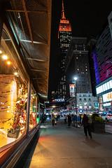 Night Time in New York City (Jocey K) Tags: empirestatebuilding sonydscrx100m6 triptocanadaandnewyork architecture buildings evening illumination macy windowdisplay street people shadows newyorkcity