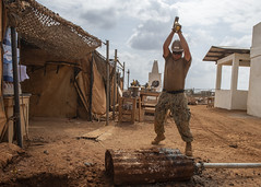 181227-F-FT438-1097 (U.S. Department of Defense Current Photos) Tags: combinedjointtaskforcehornofafrica usafricacommand cjtfhoa africom seabee alioune djibouti construction hardhat shovel fence safety dirt tractor usnavy deployed dj