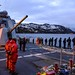 Sailors from USS Gravely man the rails as the ship departs Haakonsvern, Norway.