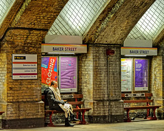 Waiting (Croydon Clicker) Tags: station railway underground tube bench wall vent skylight signs directions passenger woman waiting bakerstreet london