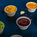 Closeup of appetizer sauces. Ketchup.