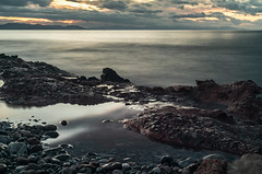 Stones Of Loneliness (panos_adgr) Tags: nikon d850 nikkor 50mm f18d long exposure photography sea seaside rocks stones seascape landscape clouds sky water earth low angle voula attica greece motion blur reflections shore winter