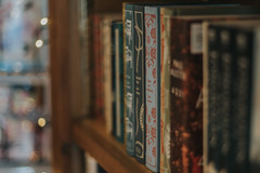 The Yellow-Lighted Bookshop... (Jess Feldon) Tags: 50mm tetbury gloucestershire cotswolds jessfeldon dof bokeh books sonya7 bookshop