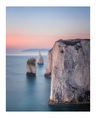 Pink and Blue at The Pinnacles (Rich Walker Photography) Tags: dorset seascape sea ocean longexposure longexposures longexposurephotography coast coastline coastal landscape landscapes landscapephotography canon england efs1585mmisusm eos eos80d sunrise morning pastel colour colours cliffs cliff