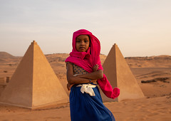 Portrait of sudanese girl visiting the pyramids of the kushite rulers at Meroe, Northern State, Meroe, Sudan (Eric Lafforgue) Tags: africa ancient ancientcivilization archaeology architecture blackpharaohs cemetery child children colorimage copyspace day desert famousplace girls horizontal lookingatcamera mausoleum meroe meroitic northsudan northerncemetery nubia onegirlonly oneperson outdoors photography placeofburial pyramid red saharadesert sudan sudan180936 thepast tomb tourism tourists traditionalclothing tranquilscene travel traveldestinations unescoworldheritagesite veil waistup northernstate sd