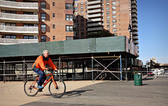 Breezy Orange (Robert S. Photography) Tags: bicycle man riding boardwalk winter breeze orange nyc brooklyn sony color dscwx150 iso100 december 2018
