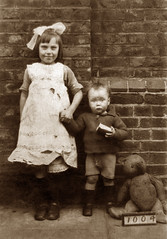 Poplar, East London (footstepsphotos) Tags: children boy girl teddy bear poplar london poverty street child east old vintage photograph past historic 1920s