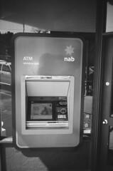 Nab ATM (Matthew Paul Argall) Tags: hanimex35es fixedfocus focusfree 35mmfilm blackandwhite blackandwhitefilm 100isofilm kentmerepan100 atm bank